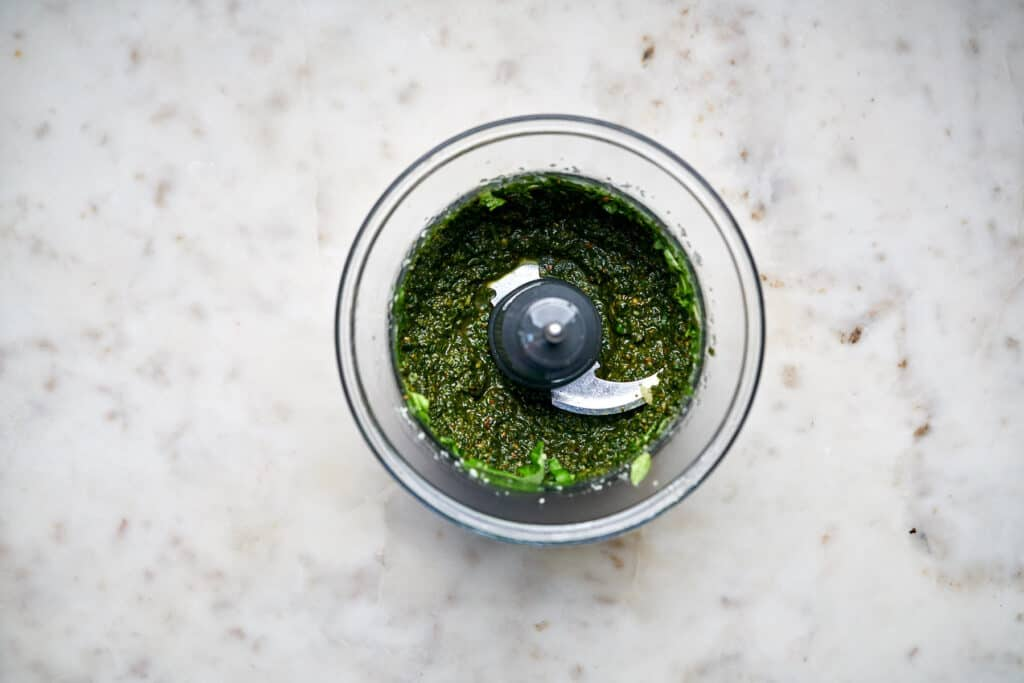 Food processor with green pesto.