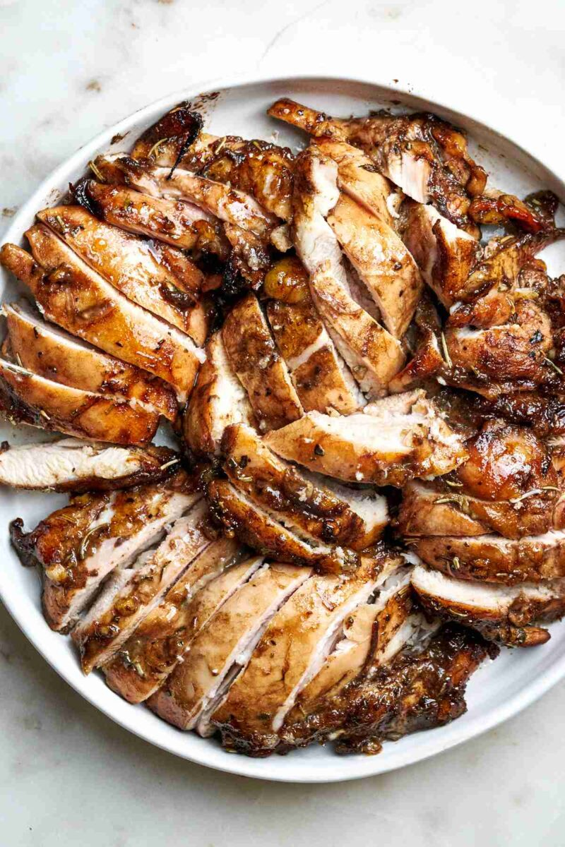 Top view of sliced chicken on a plate.