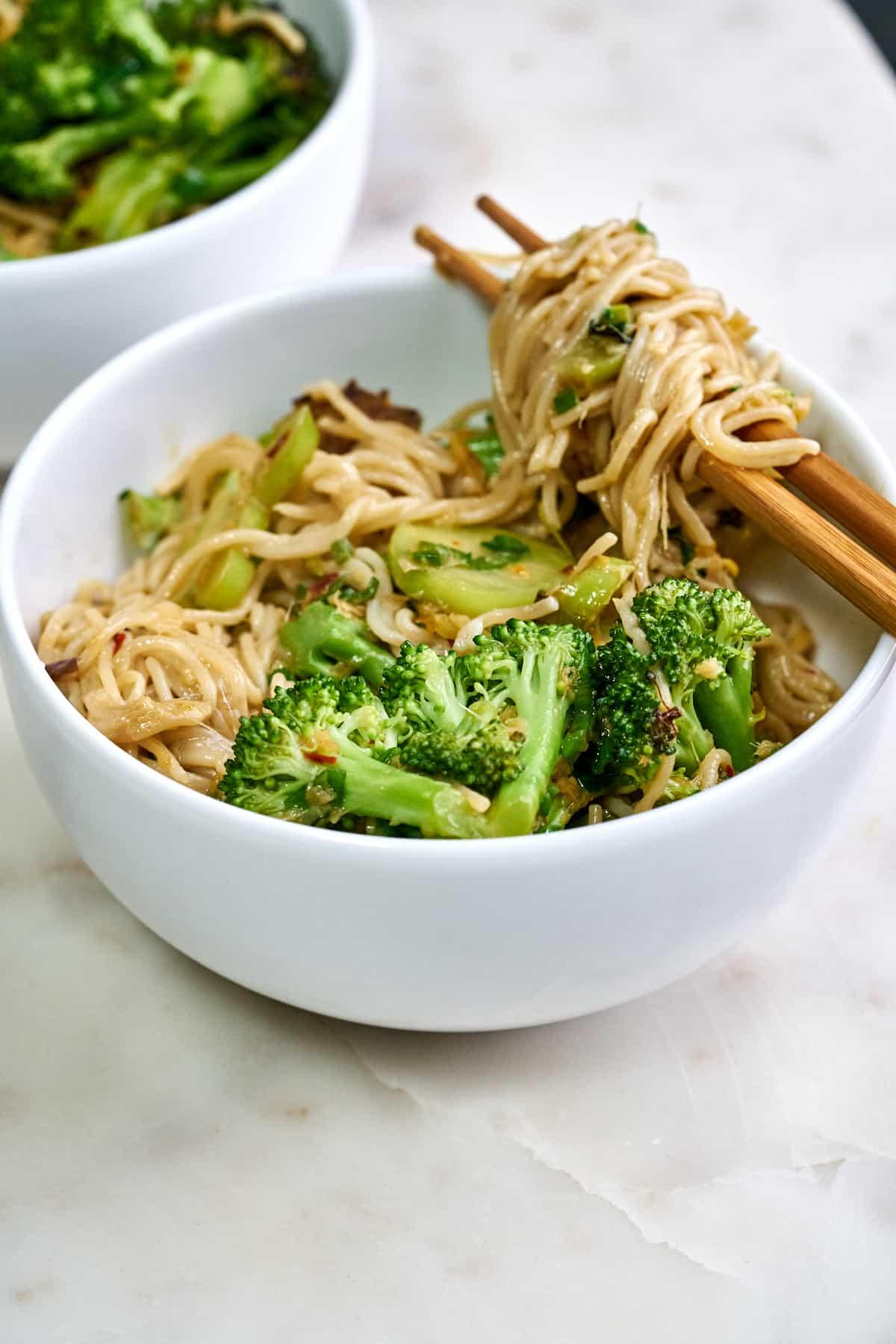 Noodles twirled on chopsticks.