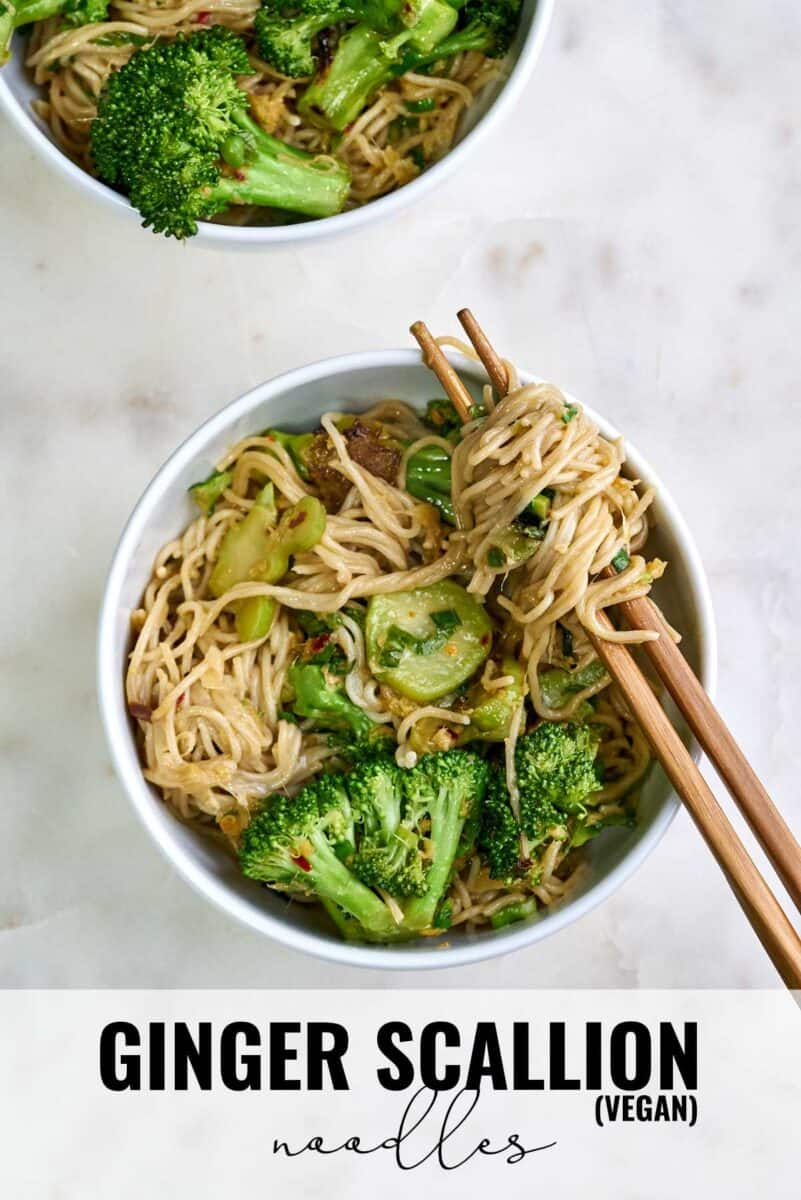 Bowl of noodles and broccoli with chopsticks.