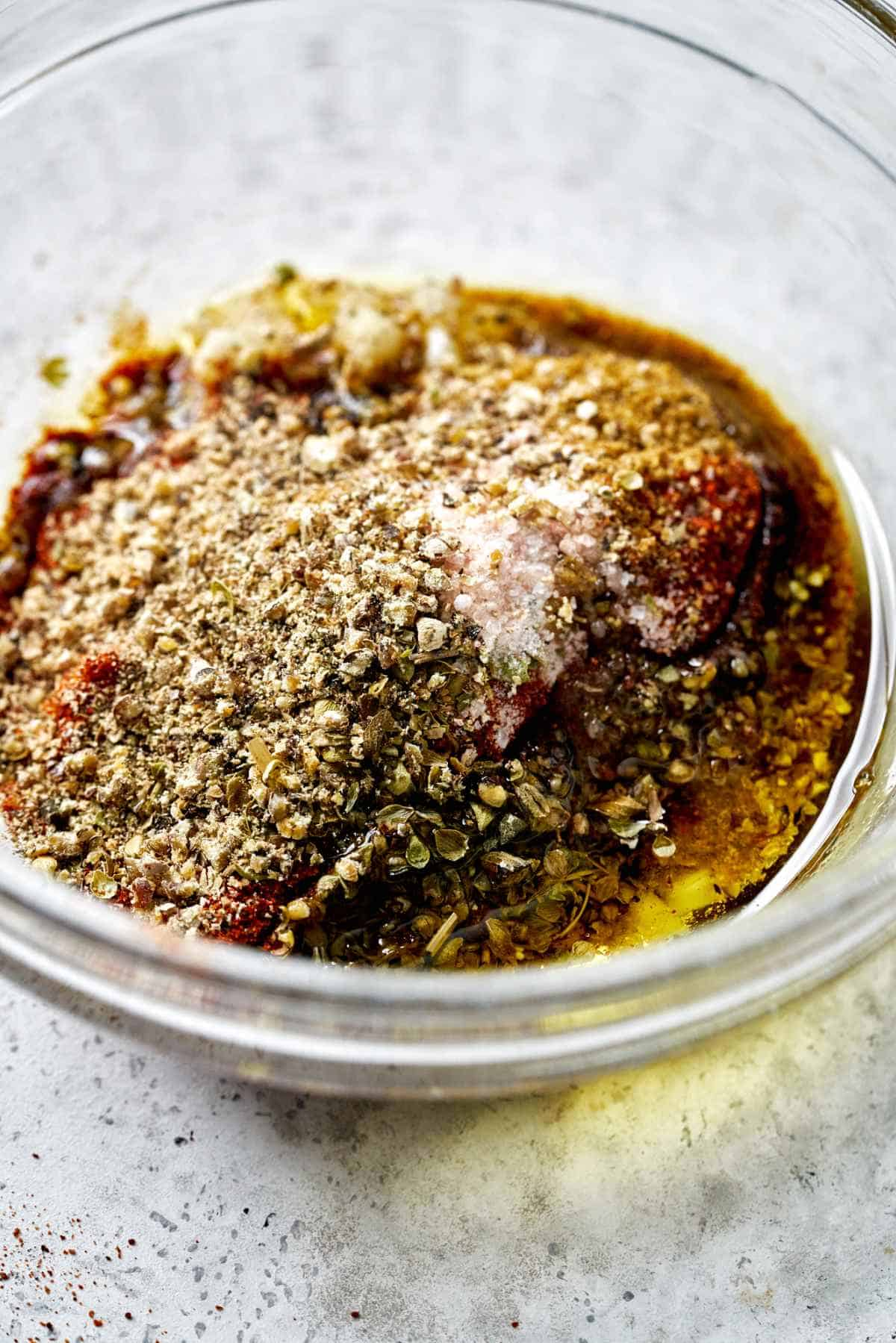 Glass bowl filled with spice mix.