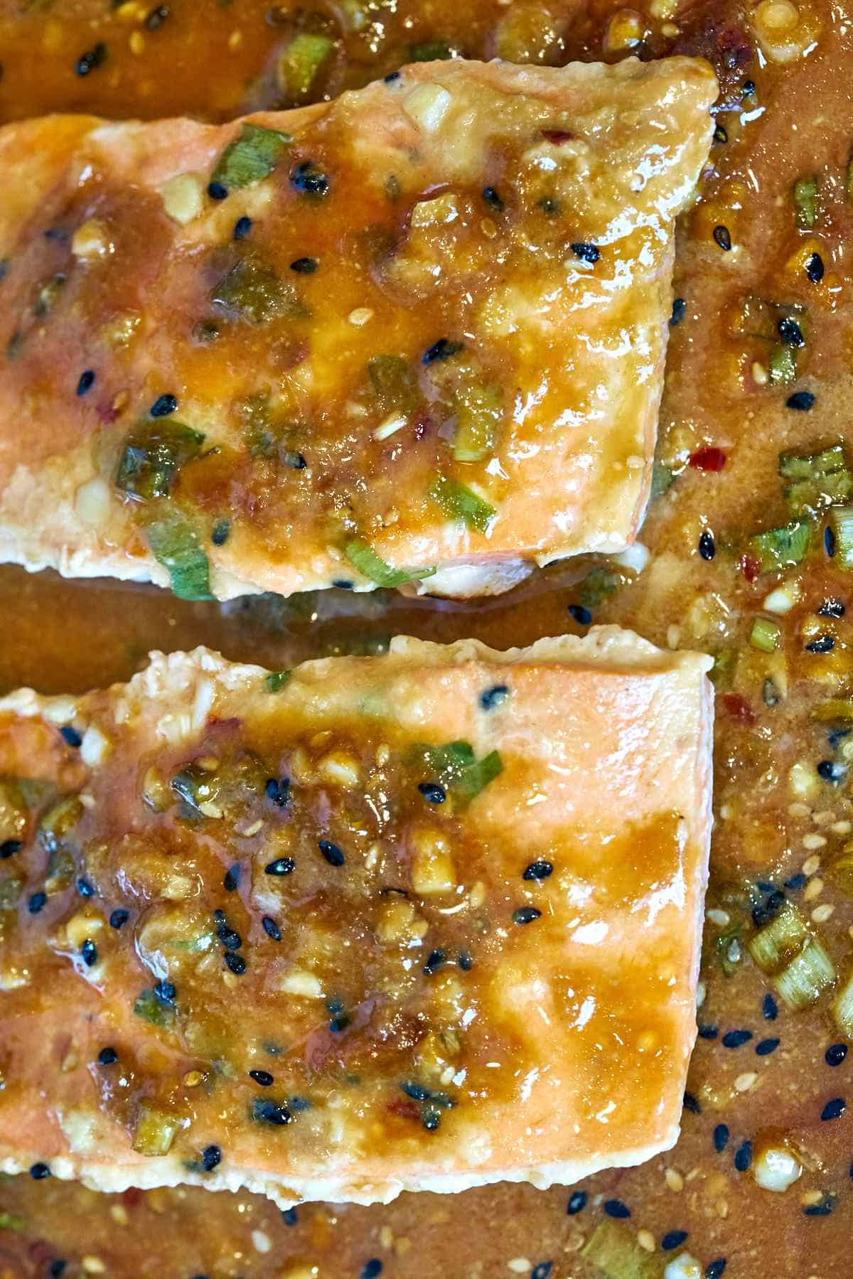 Cooked salmon on a baking sheet.