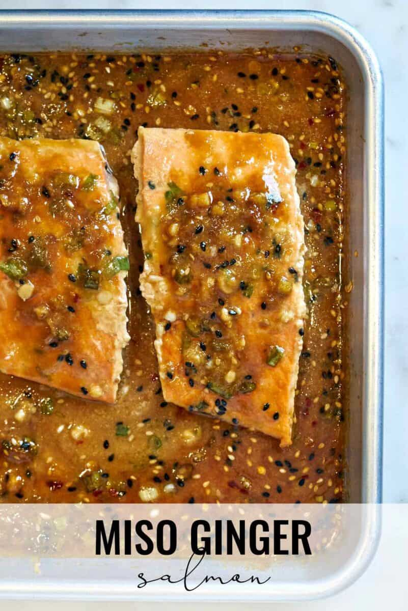 Salmon on a baking sheet with sauce.