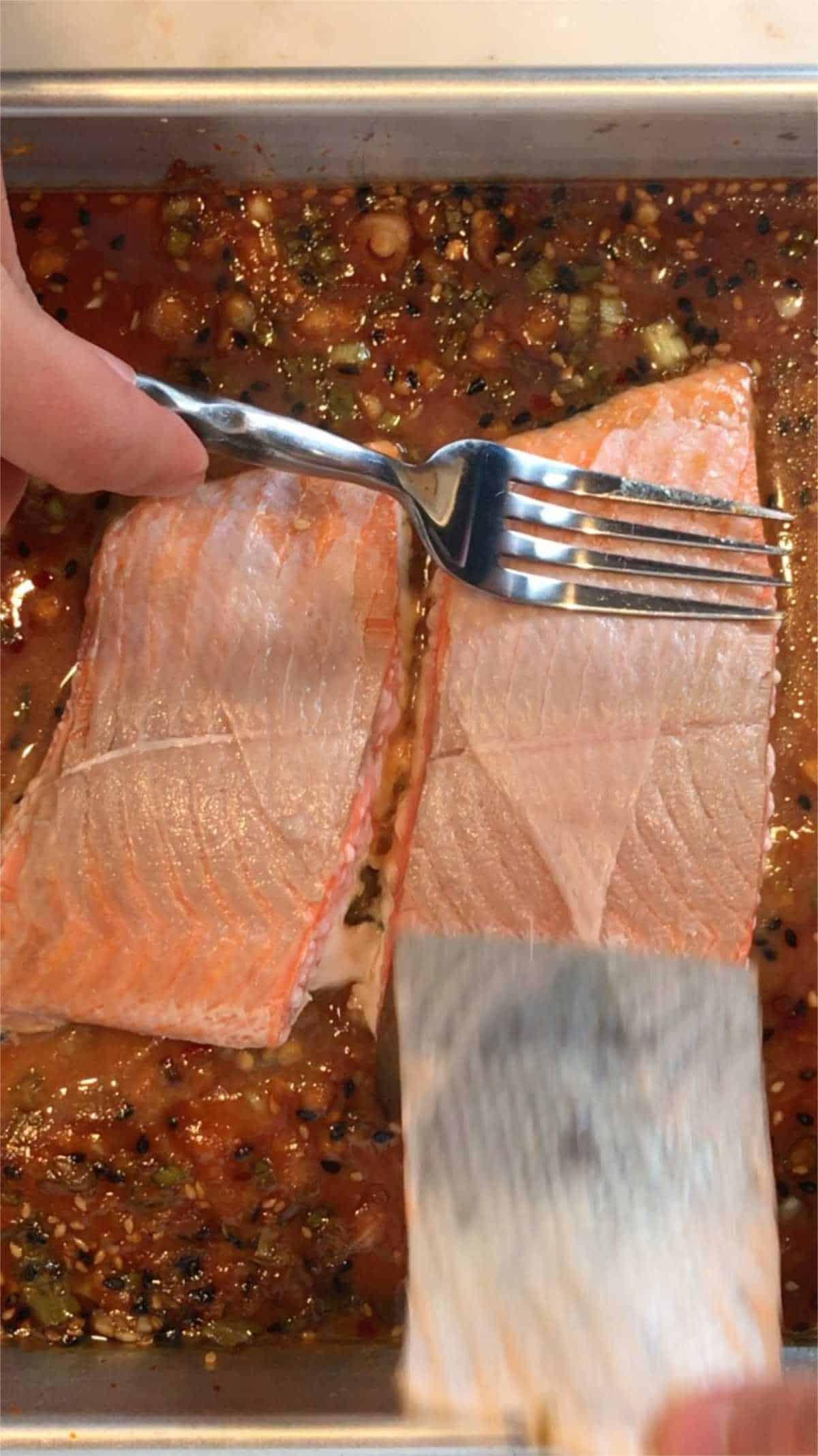 Peeling skin off salmon.