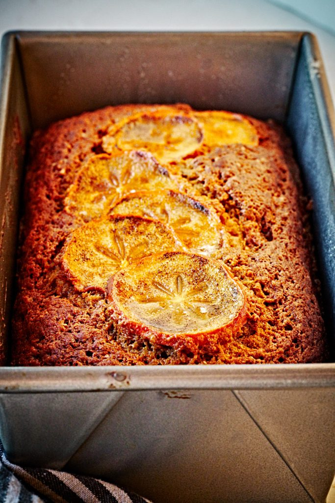 Persimmon bread loaf in a loaf pan.