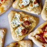 Mini triangular pizzas.