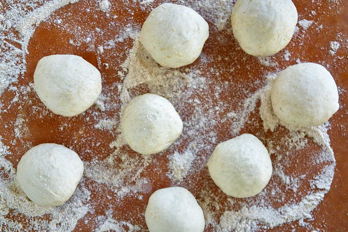 Dough balls on a cutting board.