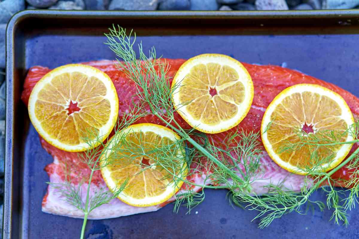 Salmon with herbs and orange slices.