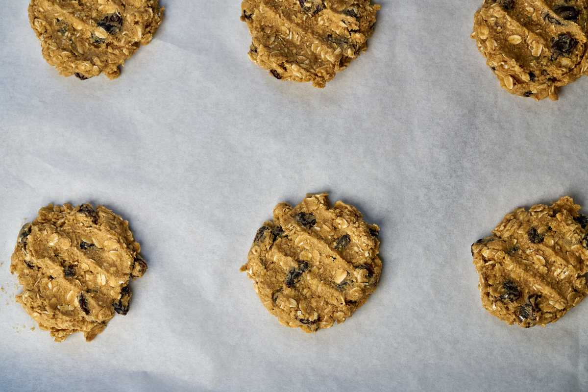 Pressed cookie dough on parchment paper.