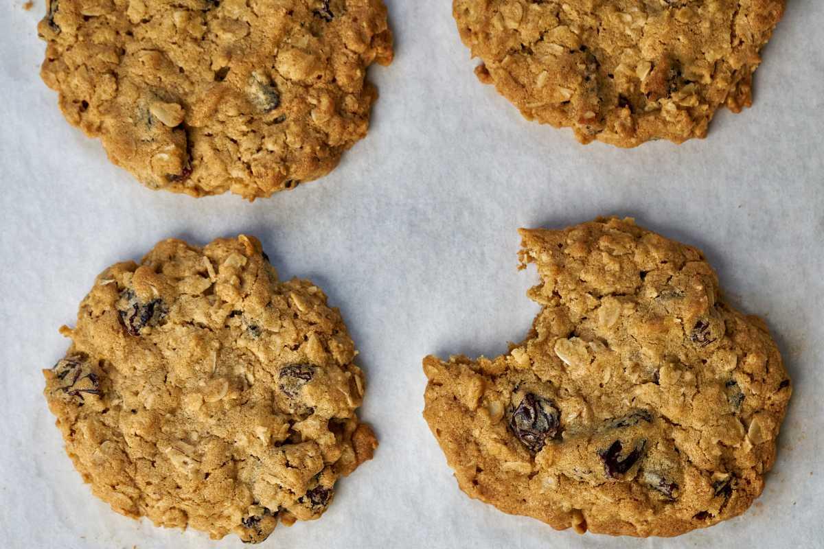 Four cookies on parchment paper.