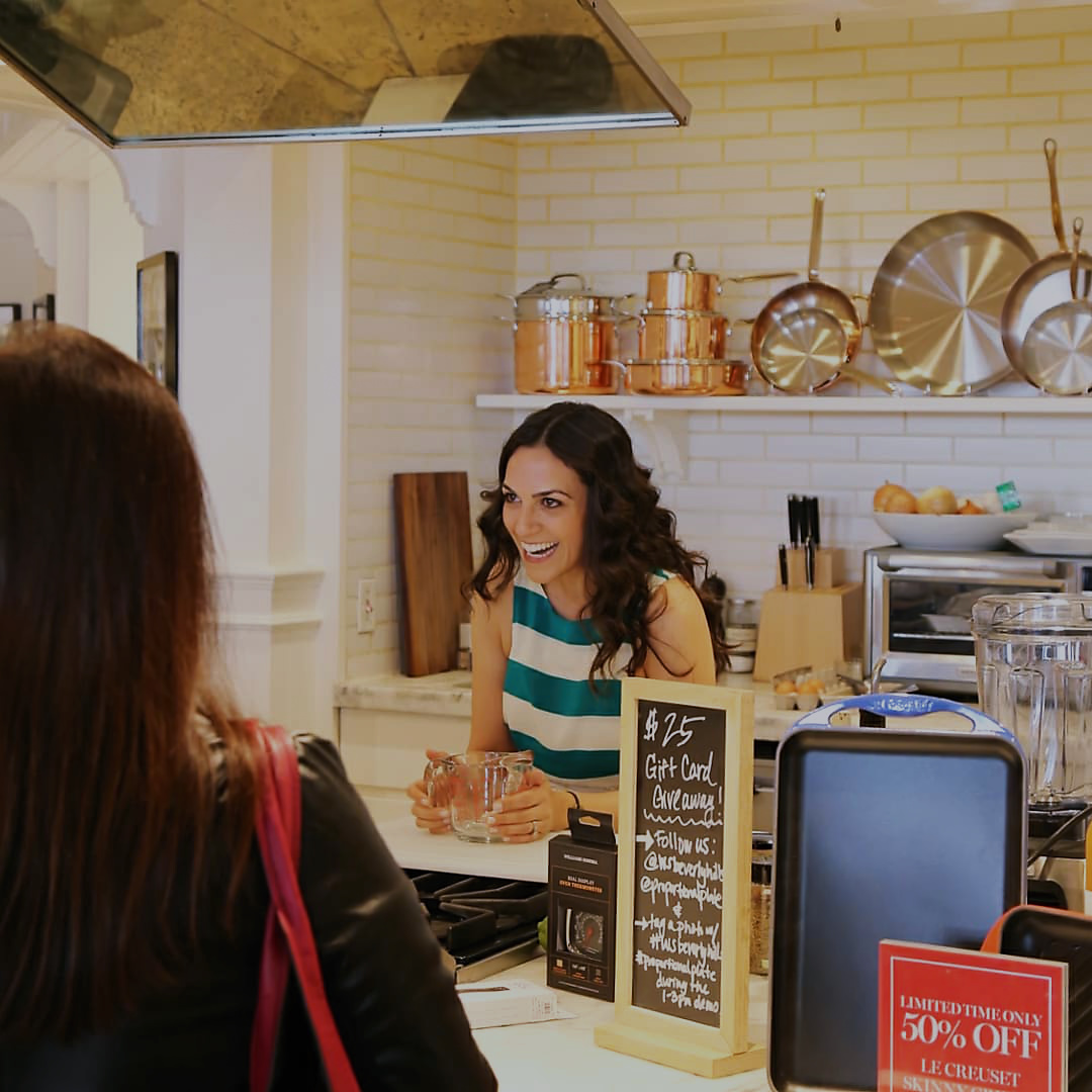 Smiling woman in an in-store kitchen.