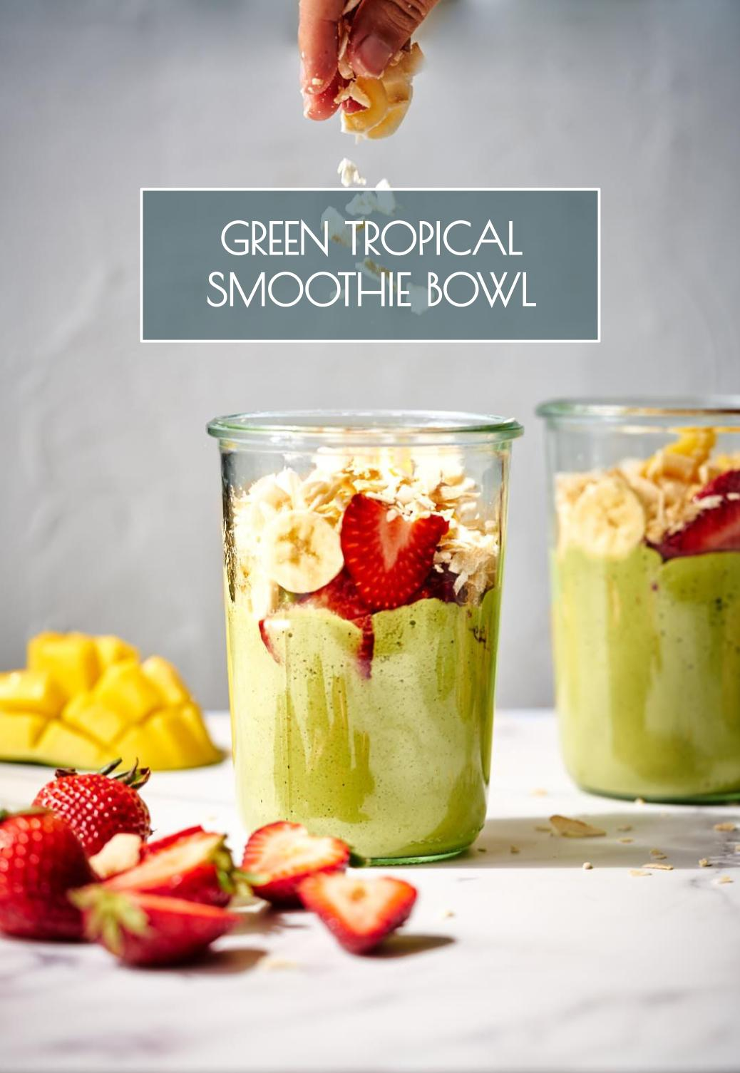 This super green tropical smoothie bowl does the triple duty of keeping you cool, getting you healthy, & making you feel like you\'re on vacation! #smoothie #greens #greensmoothie