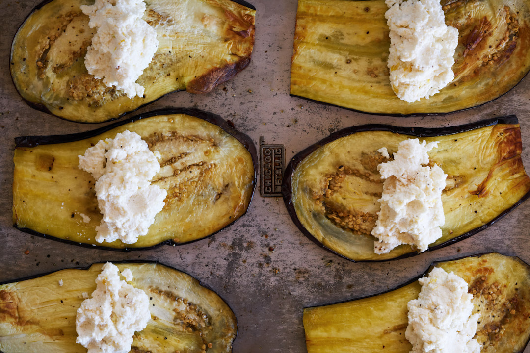Slices of eggplant covered in ricotta cheese.