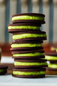 Stack of gelt and green filling.