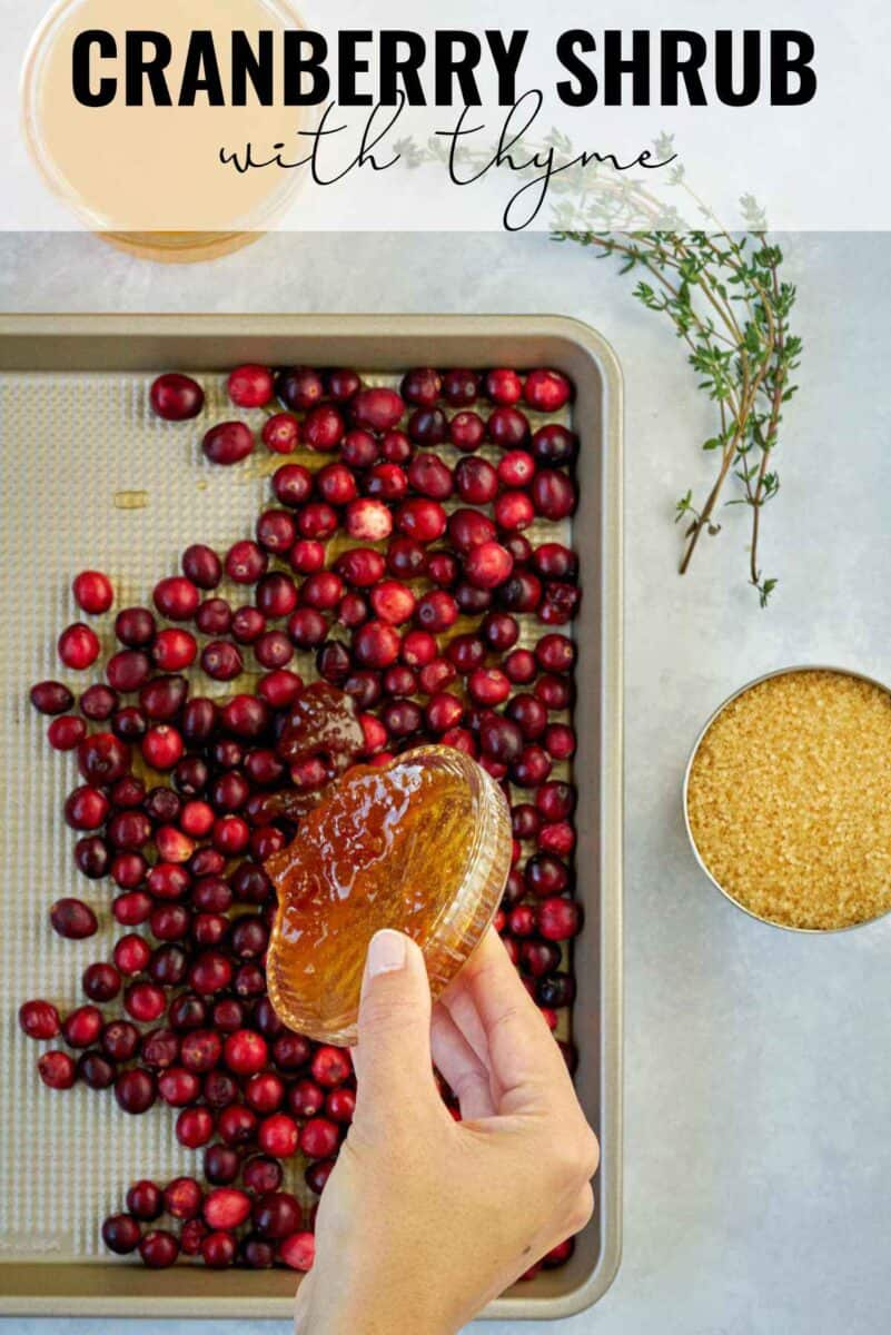 Pouring honey over cranberries on a baking sheet with title text.