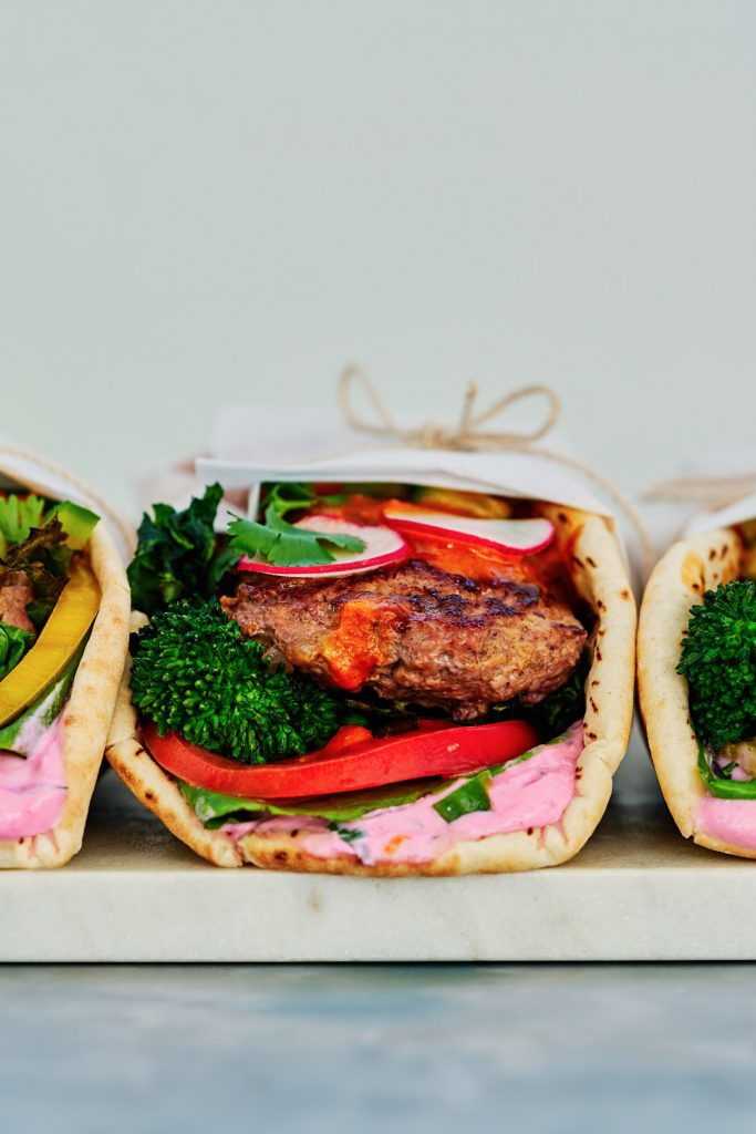 Madras Curry Lamb Burger Gyro with Broccoli Rabe and Cactus Pear Yogurt | Proportional Plate