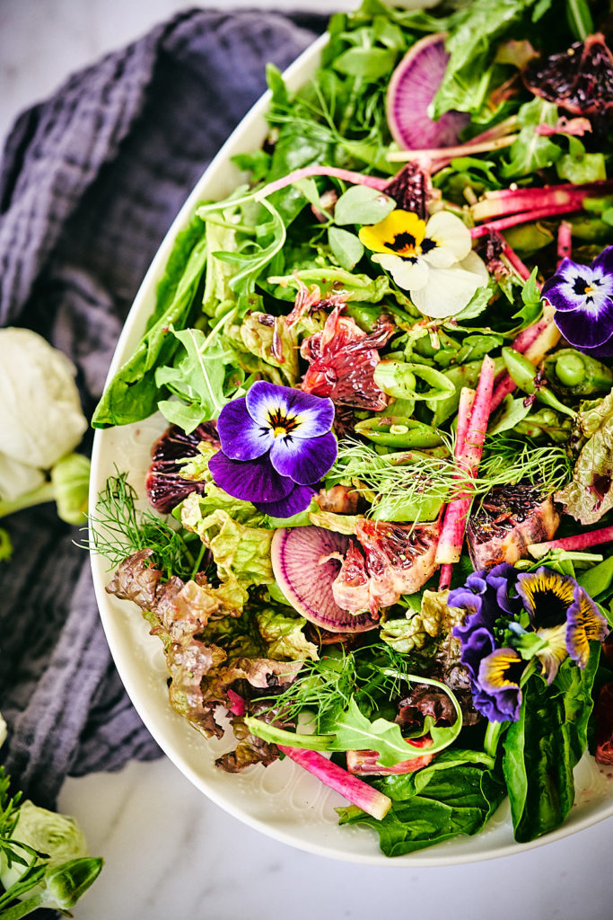 Top view of a salad with flowers.