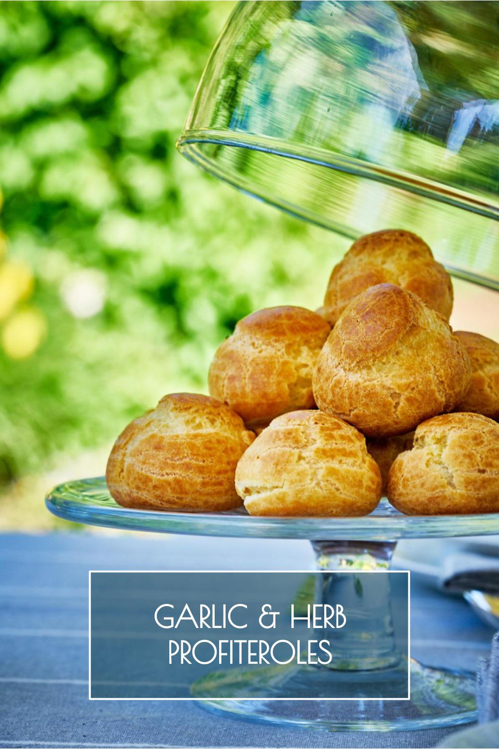 These garlic & herb savory profiteroles are just what your next party (or tea party) needs. They\'re impressive, herbaceous, and packed with rich flavor. #profiteroles #cheesefilling #garlicandherb