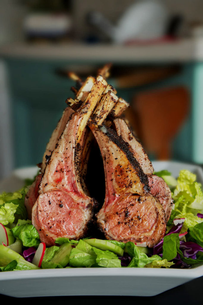 Roasted rack of lamb on a salad.