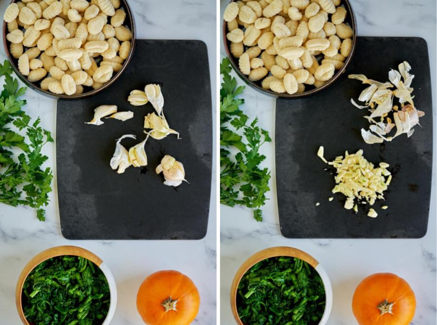 Ingredients on marble counter with garlic on black cutting board.