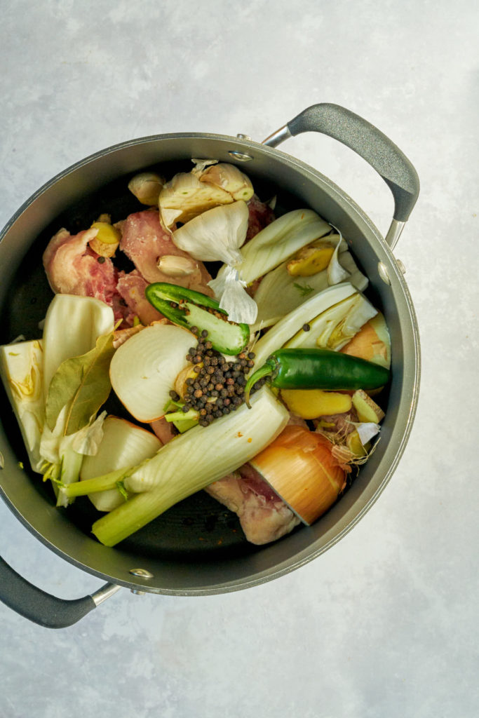 Vegetables and spices in a stock pot.