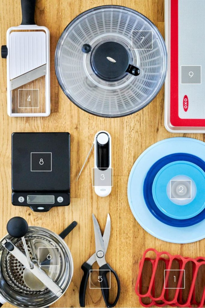 Kitchen gadgets spread out on hardwood.