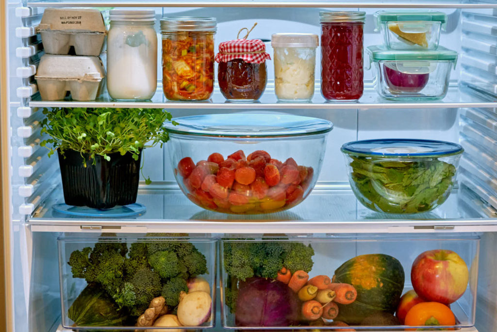 Inside of a refrigerator filled with groceries.