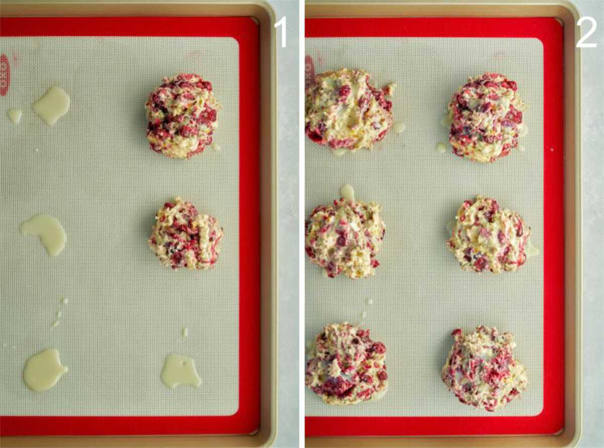 Fruit scones on a baking sheet with a silicone baking mat.