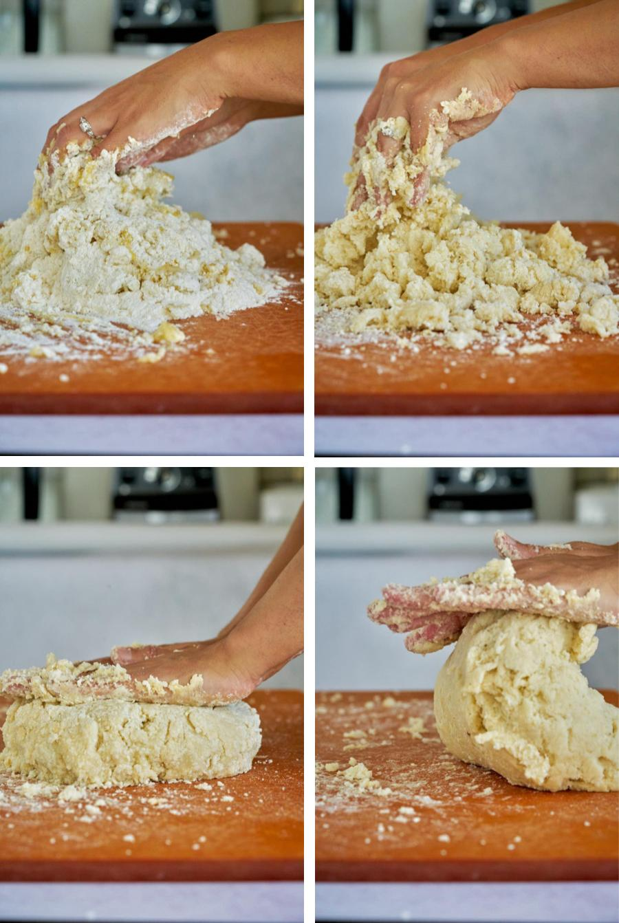 Hands mixing together dough.