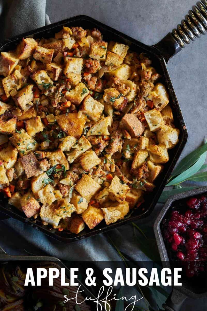 Cast iron pan with bread and sausage stuffing with title text.