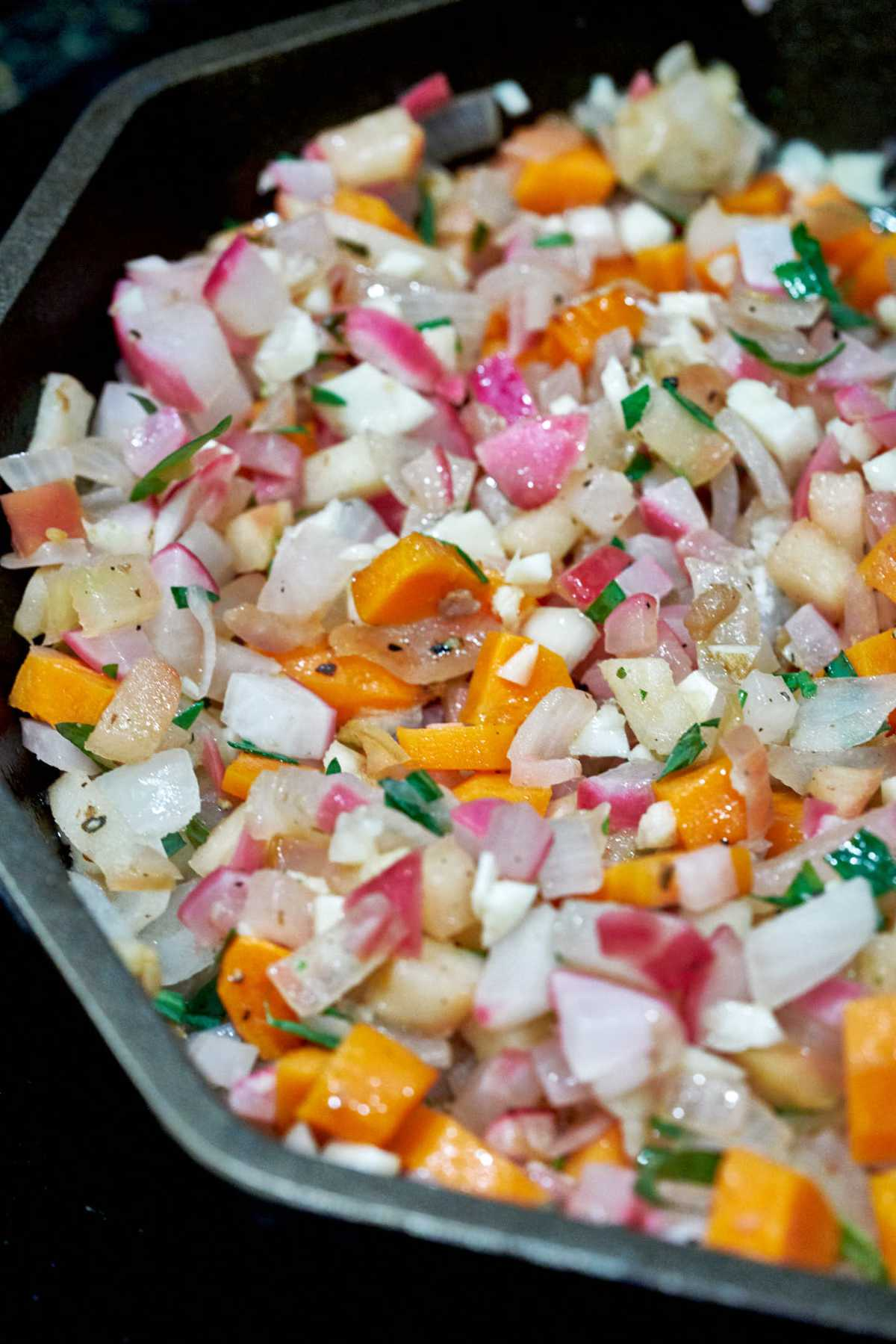 Pan with sauteed vegetables.