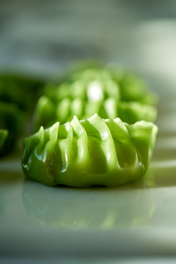 Cooked green dumplings.