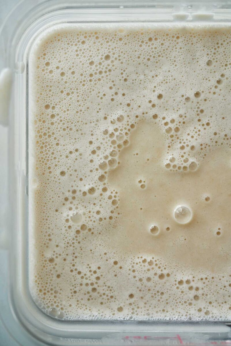 Frothy liquid in a square container.