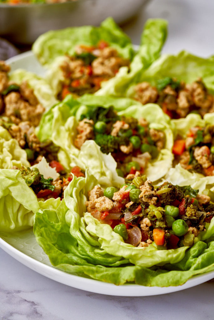 Turkey lettuce wraps on a white platter.