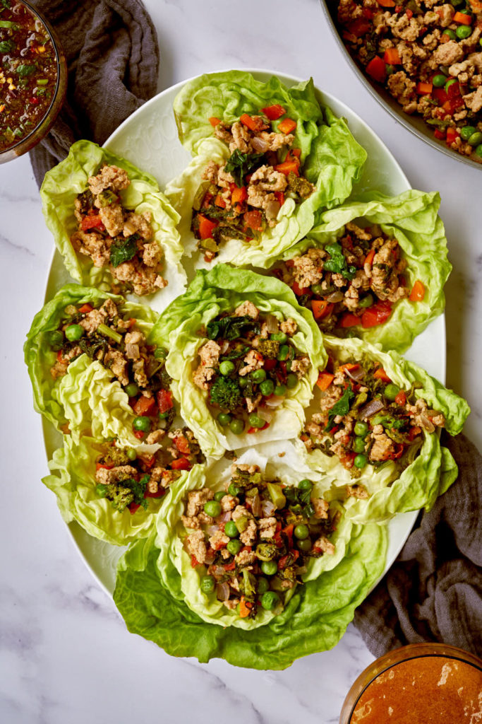 White plate filled with butter lettuce and lettuce cup filling