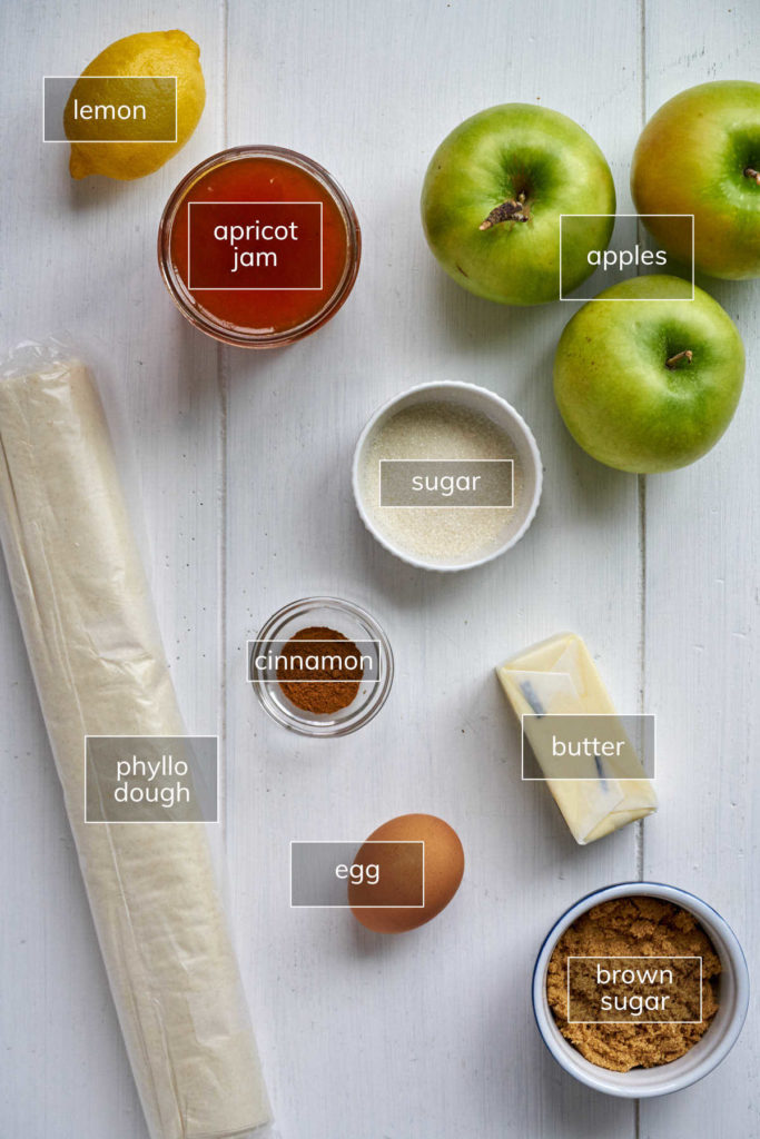 Ingredients for apple strudel on white table.