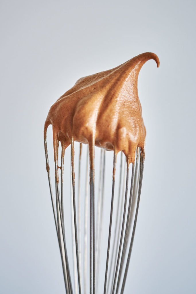 Whipped chocolate on a whisk.