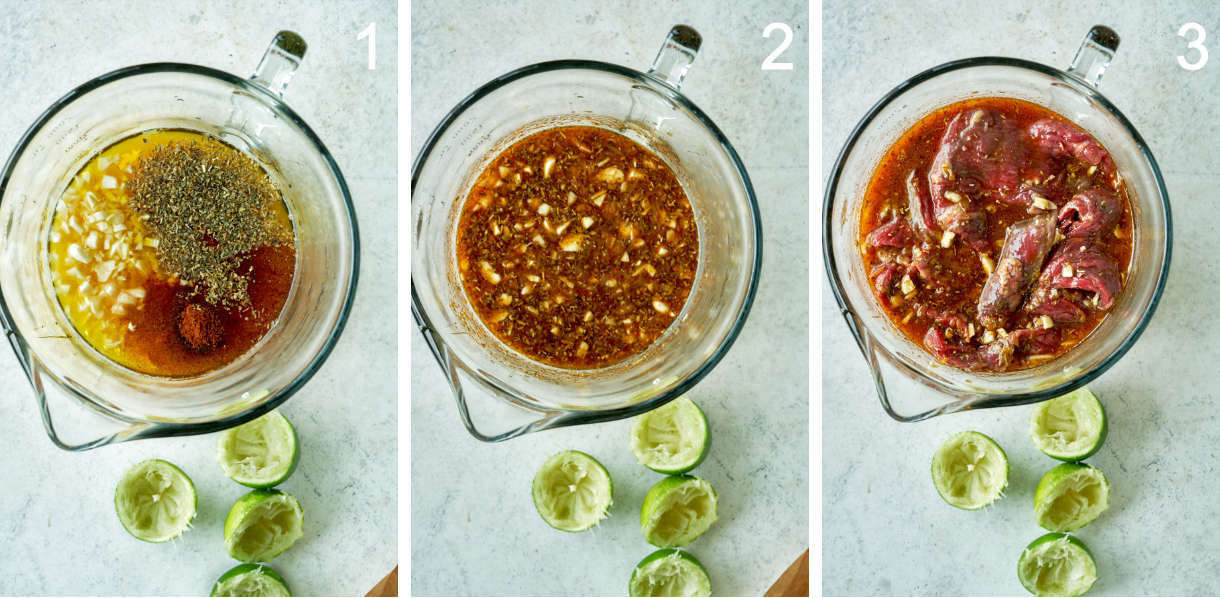 Mixing marinade or steak tacos in a glass bowl next to limes.
