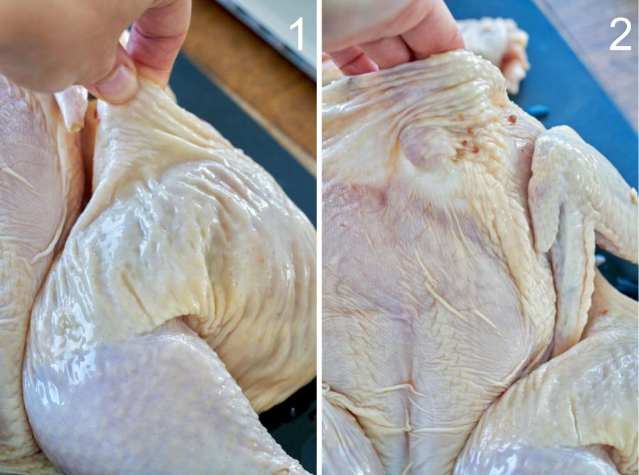 Hand showing where to put marinade under skin of chicken.