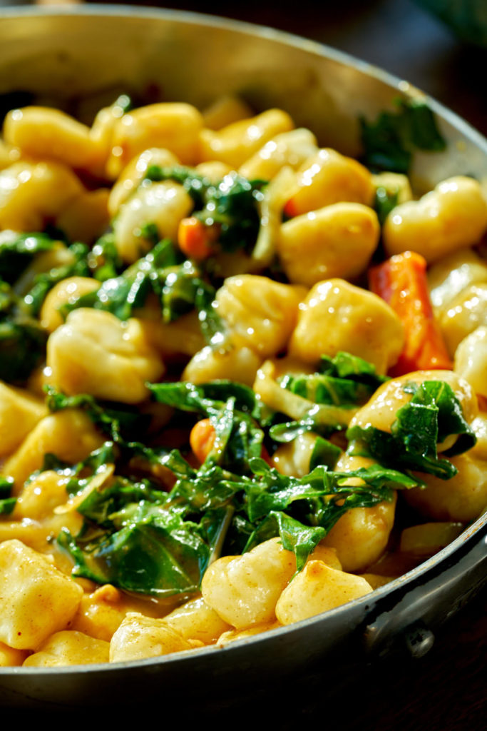 Gnocchi with winter greens and carrots with a brown sauce.