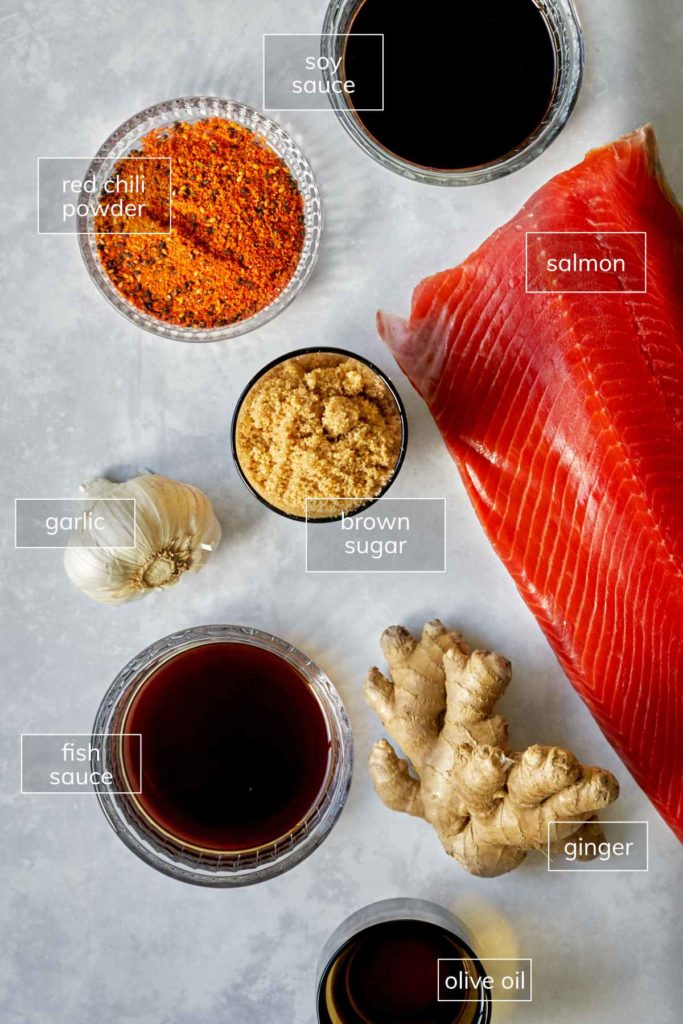Ingredients for sweet and spicy salmon including soy sauce, garlic, brown sugar, and ginger.