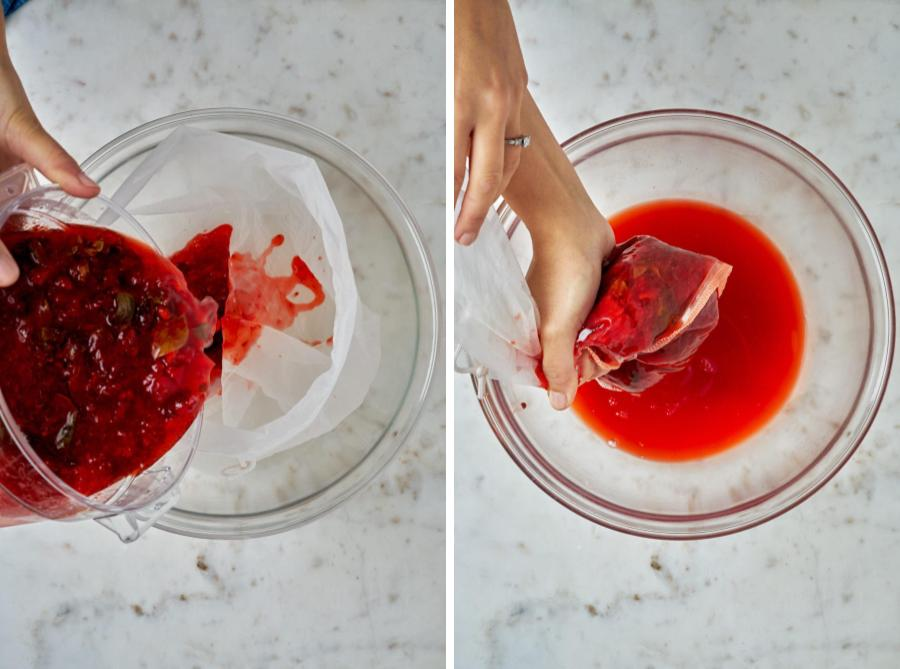 Straining strawberry shrub through a nut milk bag into a clear bowl.