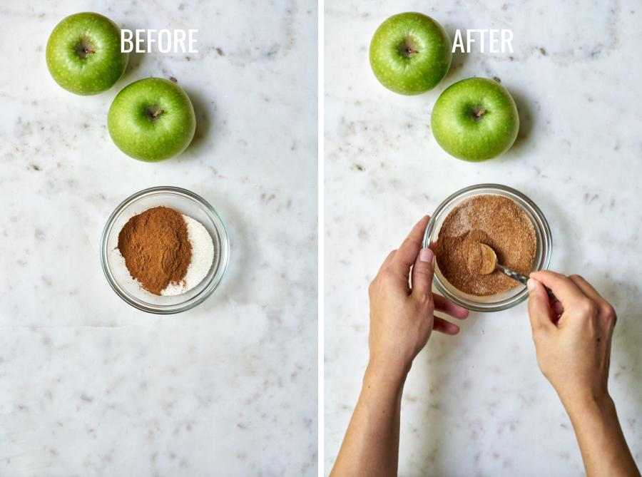 Mixing cinnamon and sugar in a bowl next to two green apples.