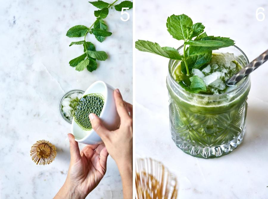 Pouring matcha into a cocktail next to a glass of green tea cocktail garnished with mint and a stirrer.