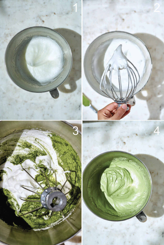 Mixing matcha into meringue in a standing mixer bowl.