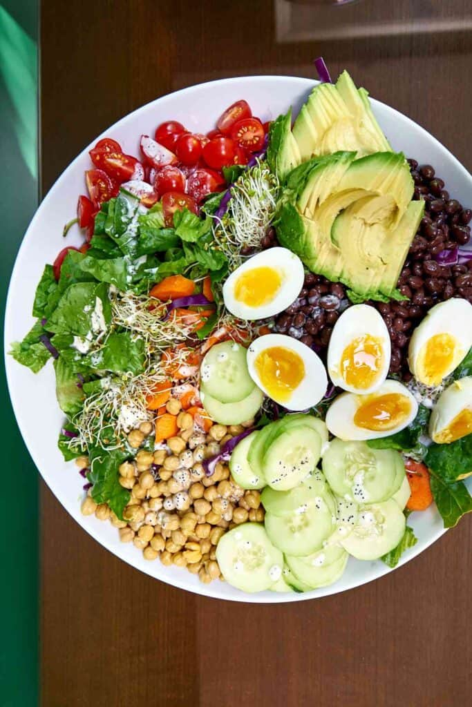 Top view of a meal salad with ingredients separated for easy picking.