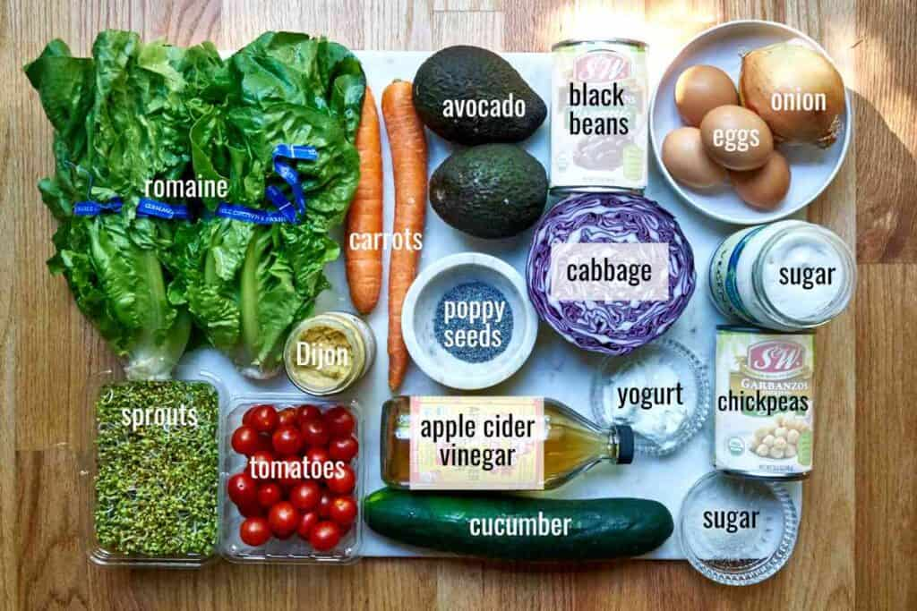 Flatlay of ingredients for meal salad with poppyseed dressing.