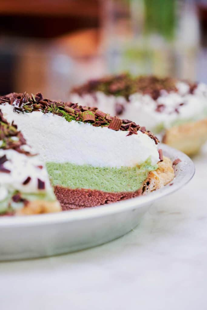 Layered french silk pie with a slice cut out.