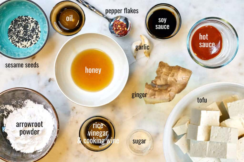 Ingredients for this tofu recipe on a white countertop.