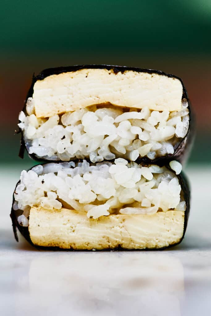 Two tofu musubi stacked on top of each other.